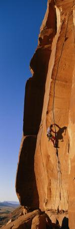 Climber on a Sandstone Wall by Bill Hatcher