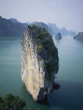 Karst Limestone Tower in Halong Bay, Vietnam by Bill Hatcher