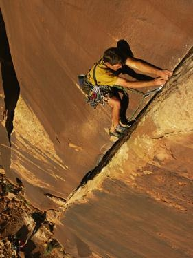 Ralph Ferrara Climbing a Rock Wall in the Utah Desert by Bill Hatcher
