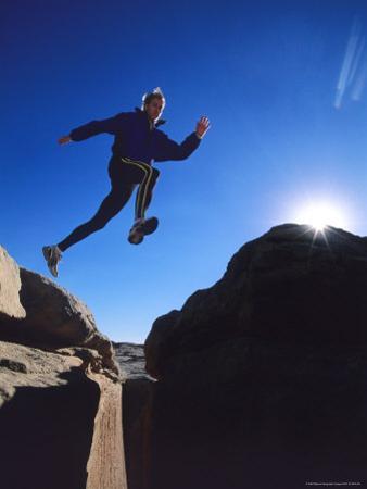 Running on a Sandstone Ridge Above Bluff, Utah by Bill Hatcher