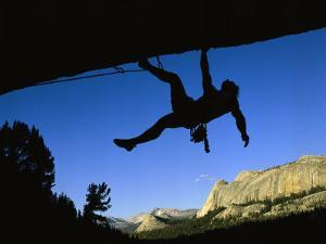 Silhouetted Rock Climber above Tuolumne Meadows by Bill Hatcher