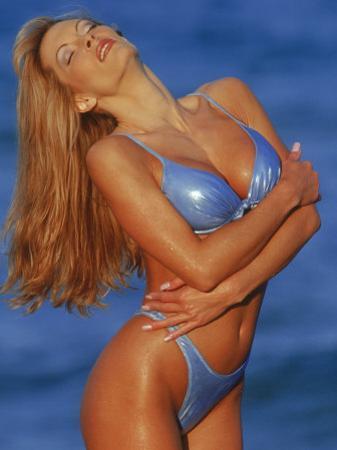 Woman in Bikini Posing on Beach