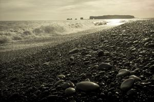 The Black Pebble Beach of Reynisfjara, Looking West to the Lava Arch of Dyrholaey by Bill Marr