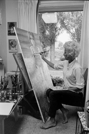 American Artist Margaret Keane Painting in Her Studio, Tennessee, 1965 by Bill Ray
