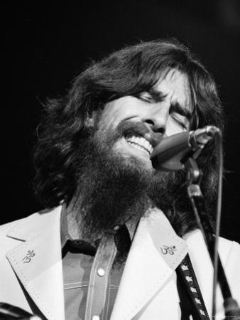 George Harrison Performing at a Rock Concert Benefiting Bangladesh, aka Kampuchea by Bill Ray