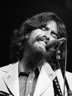 George Harrison Performing at a Rock Concert Benefiting Bangladesh, aka Kampuchea by Bill Ray