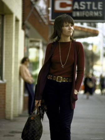Jane Fonda Carrying a Louis Vuitton Bag as She Walks Down the Street by Bill Ray