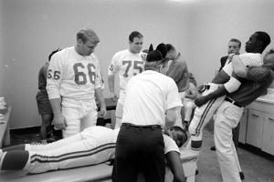 Kansas City Chiefs Football Team Players Massaged before the Championship Game, January 15, 1967 by Bill Ray