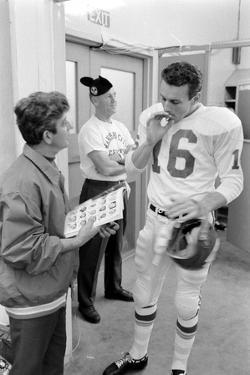 Len Dawson, Quarterback for the Kansas City Chiefs, Smokes a Ciagarette, January 15, 1967 by Bill Ray