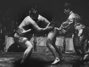 Sumo Wrestlers During Match by Bill Ray