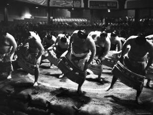 Sumo Wrestlers Performing a Ritual Dance Before a Demonstration Match by Bill Ray