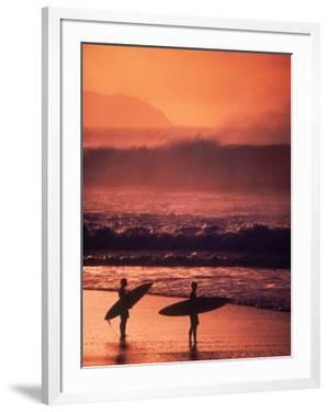 Surfers at Sunset, Oahu, Hawaii by Bill Romerhaus
