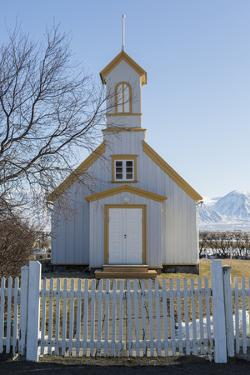 Iceland, Reynistadur. Schoolhouse behind picket fence. by Bill Young