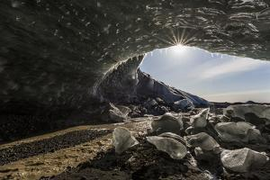 Sunburst at ice cave entrance, Iceland. by Bill Young