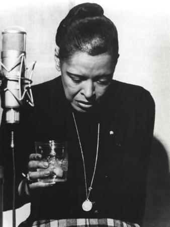 https://imgc.allpostersimages.com/img/posters/billie-holiday-looking-down-in-black-dress-with-glass_u-L-Q1184DA0.jpg?p=0