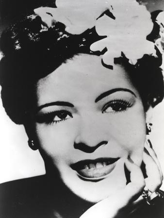 https://imgc.allpostersimages.com/img/posters/billie-holiday-smiling-with-flower-on-hair-black-and-white-portrait_u-L-Q11812C0.jpg?p=0