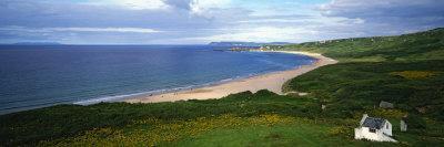 https://imgc.allpostersimages.com/img/posters/birds-eye-view-of-sea-white-stone-cottage-northern-ireland_u-L-P6J4KU0.jpg?p=0