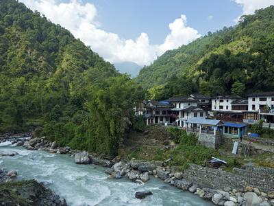 https://imgc.allpostersimages.com/img/posters/birethanti-village-and-modi-river-valley-annapurna-sanctuary-region-himalayas-nepal-asia_u-L-PFNYGZ0.jpg?artPerspective=n