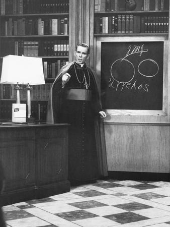 https://imgc.allpostersimages.com/img/posters/bishop-fulton-sheen-presents-an-illustrated-theology-lesson-on-his-tv-show-life-is-worth-living_u-L-Q10WX250.jpg?artPerspective=n