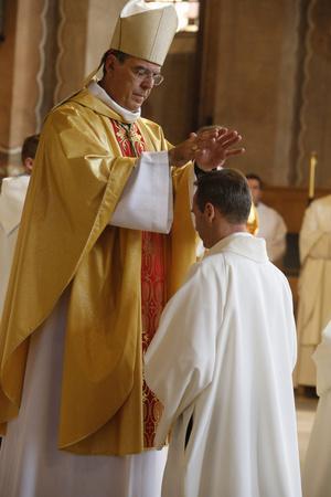 https://imgc.allpostersimages.com/img/posters/bishop-michel-aupetit-conducting-deacon-ordination-in-sainte-genevieve-s-cathedral-nanterre_u-L-Q1GYILQ0.jpg?artPerspective=n