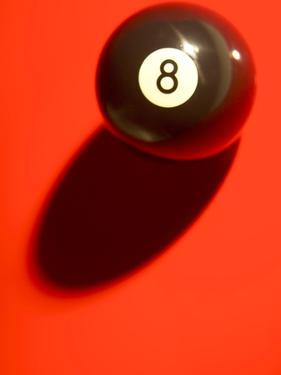 Black and White Eight Ball on with Shadow on Red Background