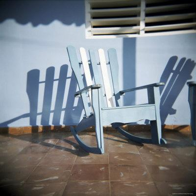 https://imgc.allpostersimages.com/img/posters/blue-and-white-chair-outside-house-vinales-cuba-west-indies-central-america_u-L-P2QSR10.jpg?p=0
