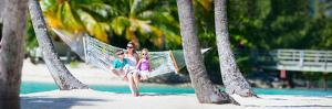 Mother and Two Kids Relaxing on Hammock at Tropical Beach by BlueOrange Studio
