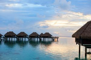Over Water Villas at Sunset in French Polynesia by BlueOrange Studio