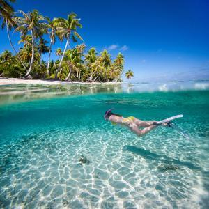 Woman Swimming Underwater in Clear Tropical Waters in Front of Exotic Island by BlueOrange Studio