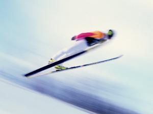 Blurred Action of Sky Jumper Flying Through the Air, Lake Placid, New York, USA