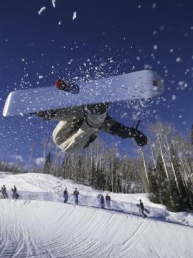 Blurred Action of Snowboarder, Aspen, Colorado, USA