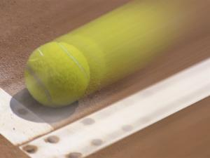 Blurred Image of a Tennis Ball Landing In Bounds