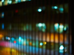 Blurred Image of Office Windows at Night with Illuminating Lights in New York City