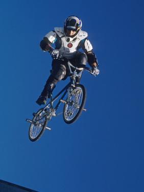 Bmx Cyclist Flys over the Vert