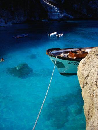 https://imgc.allpostersimages.com/img/posters/boat-in-water-of-cala-de-mariolu-golfo-di-orosei-italy_u-L-P3SGOX0.jpg?p=0