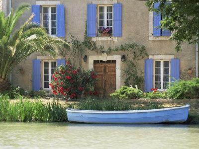 https://imgc.allpostersimages.com/img/posters/boat-moored-alongside-house-on-the-bank-of-the-canal-du-midi-aude-france_u-L-P1TIOF0.jpg?p=0