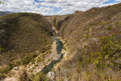 https://imgc.allpostersimages.com/img/posters/boat-navigable-part-of-the-coco-river-before-it-narrows-into-the-somoto-canyon-national-monument_u-L-PWFHBT0.jpg?p=0
