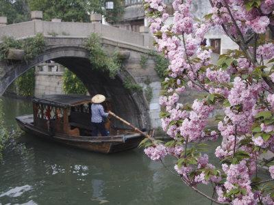 https://imgc.allpostersimages.com/img/posters/boat-passing-under-bridge-along-canal-suzhou-jiangsu-china-asia_u-L-P91HWV0.jpg?p=0
