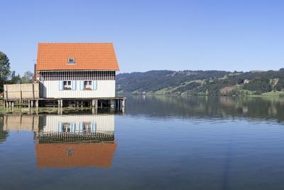 https://imgc.allpostersimages.com/img/posters/boathouse-at-alpsee-lake-immenstadt-allgau-bavaria-germany-europe_u-L-PQ8NXZ0.jpg?p=0