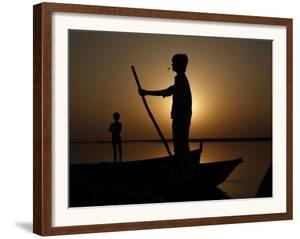 Boatman Prepares to Anchor His Boat, after the Day's Work in River Ganges, in Allahabad, India