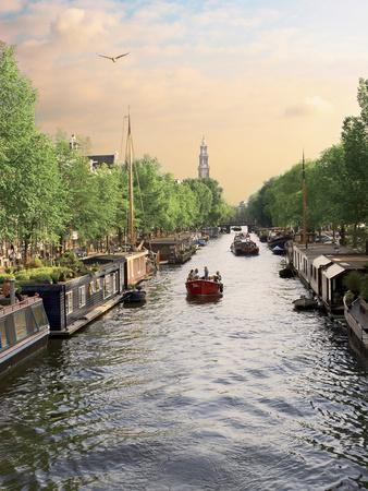 https://imgc.allpostersimages.com/img/posters/boats-cruise-along-a-canal-with-the-zuiderkerk-bell-tower-in-the-background-amsterdam-netherlands_u-L-PHAV1Y0.jpg?p=0