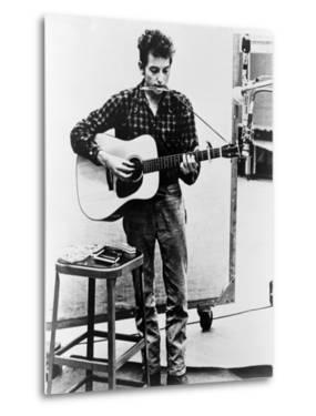 Bob Dylan Playing Guitar and Harmonica into Microphone. 1965