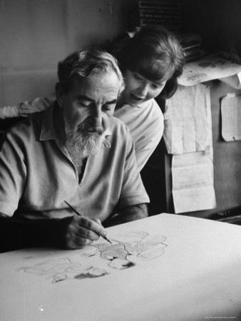 Cartoonist of American Theater Personalities Al Hirschfeld Working on a Group of Caricatures