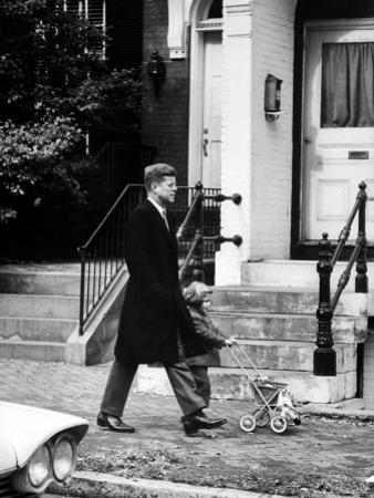 President Elect, John F. Kennedy, Taking a Walk with Daughter Caroline and Her Doll Carriage