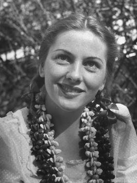Actress Joan Fontaine Sporting Pigtails and Her Natural Freckles in Yard at Home by Bob Landry