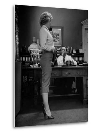 Actress Marilyn Monroe Talking Sexily on Phone While Displaying Her Talents for Producer Jerry Wald by Bob Landry