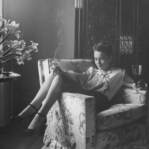 Actress Olivia de Havilland with Cigarette and Glass of Beer in While Relaxing at Home by Bob Landry