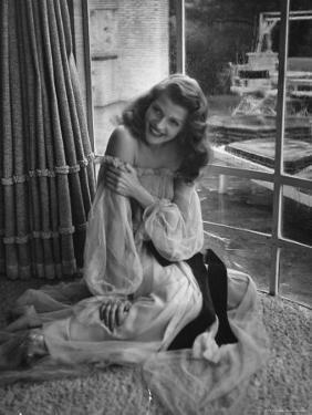 "Actress Rita Hayworth Wearing Nude Souffle Negligee in movie ""Gilda"" by Bob Landry"