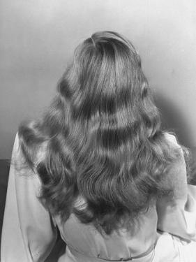 Actress Veronica Lake Posing with Her Glorious, Wavy Honey Blond Hair Cascading over Her Shoulders by Bob Landry