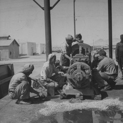 Arabians Working in the Oil Co.'s Garage by Bob Landry